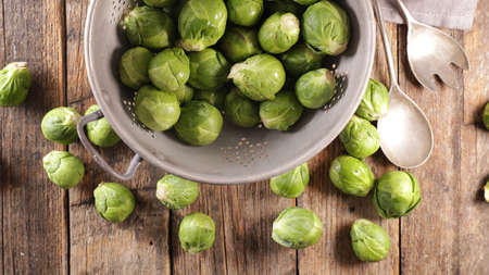raw brussels sprouts on wood background Фото со стока