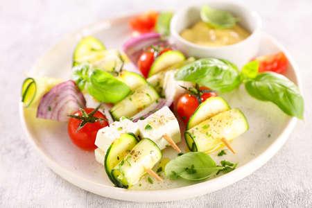 Kebabs, vegetarian on skewer with dipping sauce