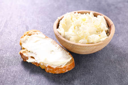 cottage cheese- bowl of cheese and slice of bread Фото со стока