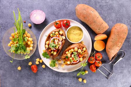sweet potato with grilled chickpea, tomato and onion Фото со стока