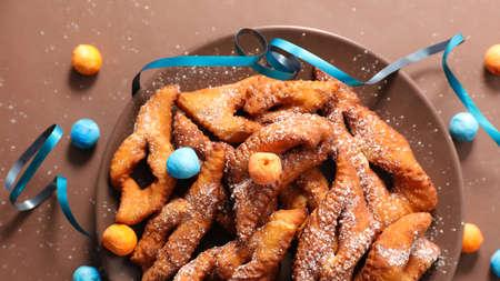 crispy angel wings and carnival decoration Фото со стока