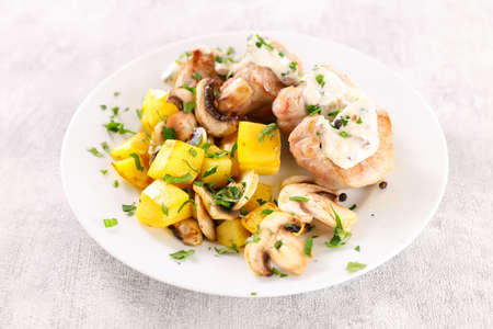 filet mignon with cream and potato Фото со стока