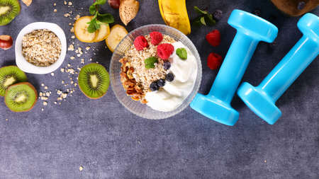 healthy breakfast- granola, yogurt and berry fruit Фото со стока