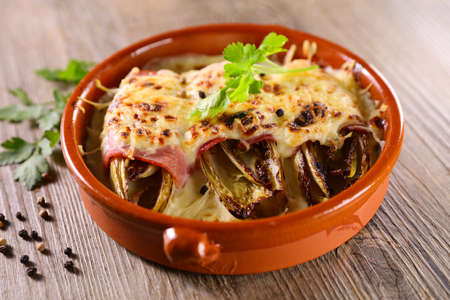 baked chicory with ham and cheese