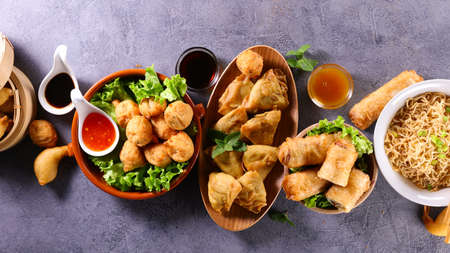 asian food background with various dishes Фото со стока
