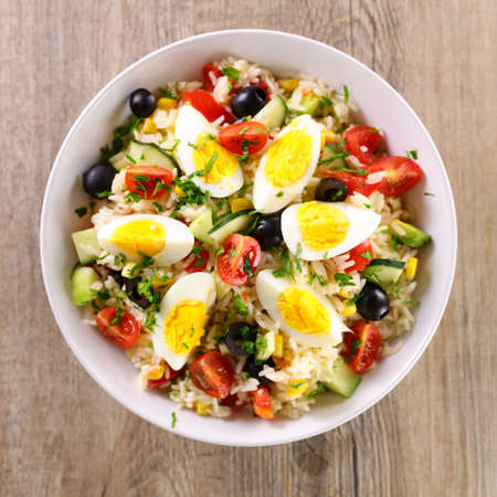 vegetable salad with rice, tomato, cucumber and egg