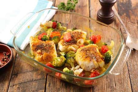 fish fillet with spices and vegetables Фото со стока