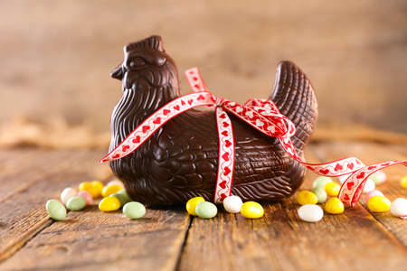 easter egg, easter chocolate, chicken on wood background