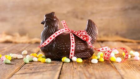 chocolate easter chicken, hen on wooden background