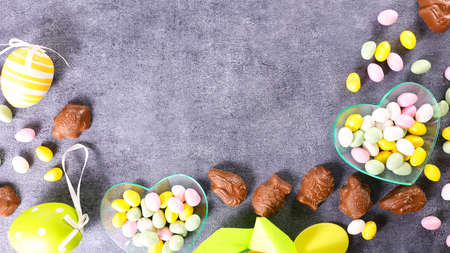 easter composition banner- chocolate, egg, candy background