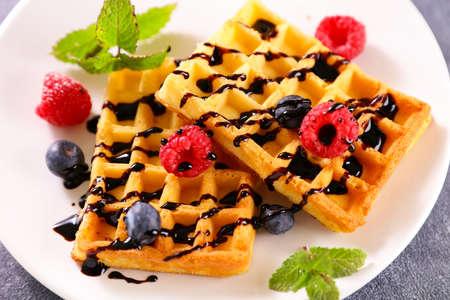 waffle with berries fruits and chocolate Фото со стока