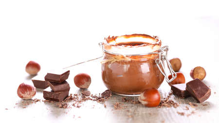 chocolate spread in jar and hazelnut