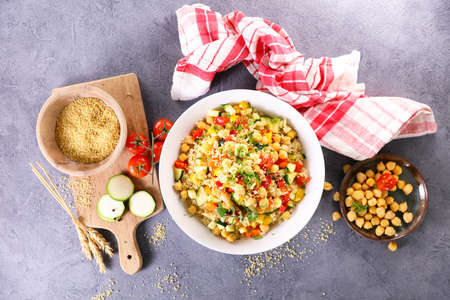 bowl of vegetarian couscous and ingredients Фото со стока