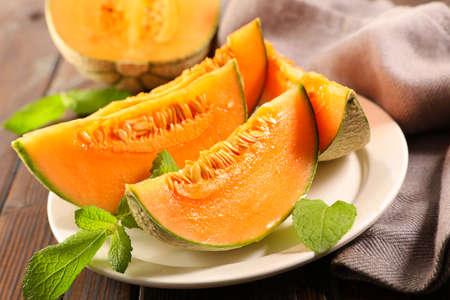 melon slice and mint leaf
