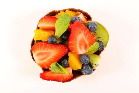 fresh fruit salad isolated on white background