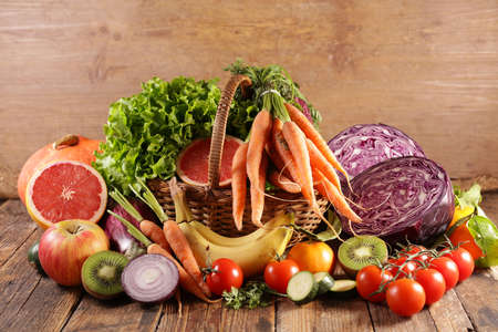 fruit and vegetable on wicker basket Фото со стока