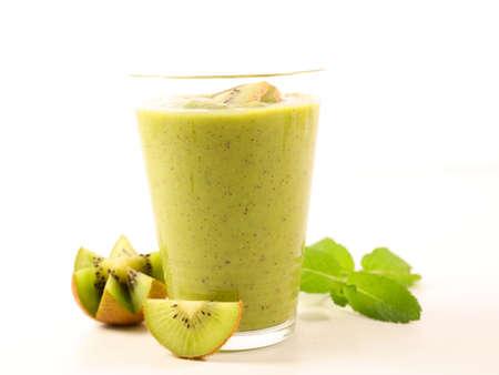 green smoothie with kiwi on white background