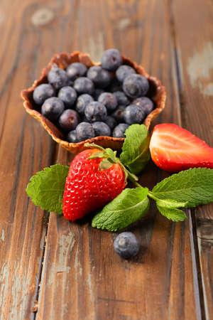 fresh berries fruits- strawberry and blueberry Фото со стока