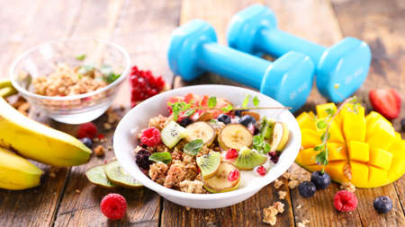 diet food concept- breakfast and dumbbell Stock Photo