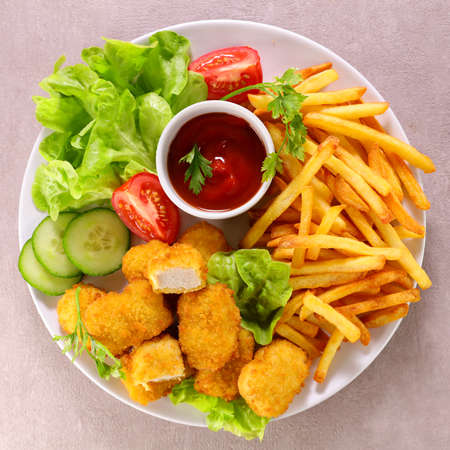 fried chicken, french fries and ketchup