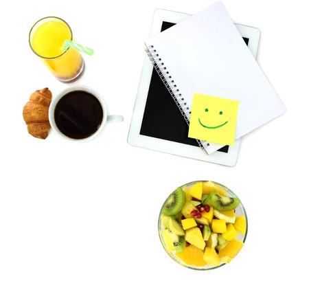 Digital tablet, coffee and breakfast