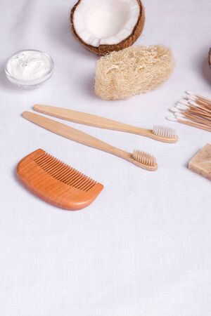 eco body care products made of wood, bamboo and loofah on linen