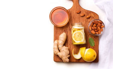 Food useful for immunity. Lemon in honey-sugar syrup on a white background. Copy space