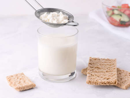 Strained milk of kefir grain. Fermented fermented milk drink in a glass. Stock Photo