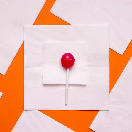 DIY Halloween candy ghost step by step. Image two. Put a smaller square on a large napkin and candy on it