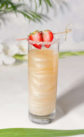Golden shimmer drink with strawberries