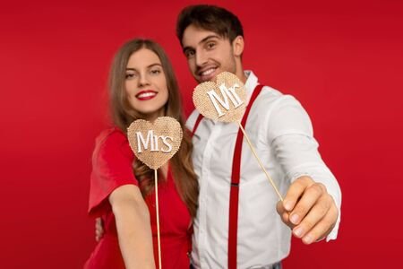 Selective focus of smiling beautiful young couple have fun together in elegant outfit