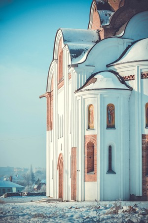 brightly lit: side part of the Christian church, brightly lit by the sun in winter Stock Photo