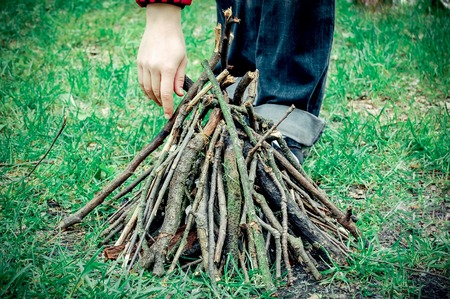 kindling: dry twigs for kindling a fire and a womans hand Stock Photo