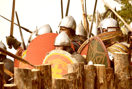 rus: Samara, Russia, the festival of historical reconstruction ancient Russia ages 11-13 - August 16, 2013: many soldiers with shields ready to attack in historical dress on the festival of historical reconstruction of life of the ancient Kievan Rus