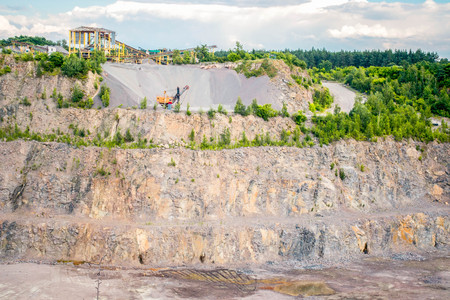 panorama of granite quarry with the machines to work, general view Stock Photo