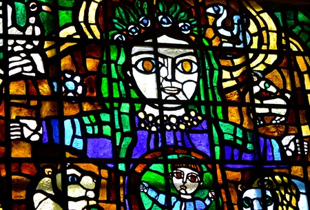 stained glass windows: White Church, Ukraine, April 16 2015 Glass stained-glass windows in the House of Culture:-woman holds a child multicolored stained glass
