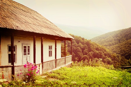 slate roof: Ukrainian old house in the Carpathian mountains background with a slate roof filter
