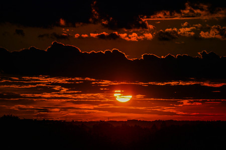 beautiful heaven: dark sunset sunrise with dark clouds with horizon Stock Photo