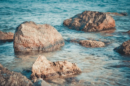 timelapse: stones on the beach in the clear water, the filter Stock Photo