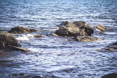 protrude: rocks protrude from the water by day,  filter
