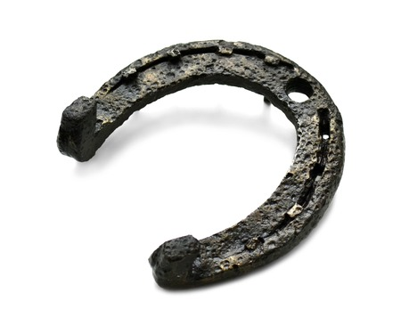 metalline: historical and ancient metal horseshoe on a white background Stock Photo
