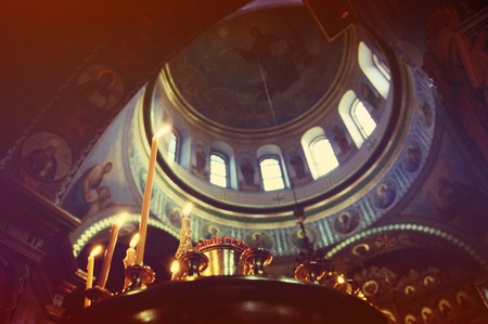 christian candle: Candle and Dome of the Christian church inside, dark filter
