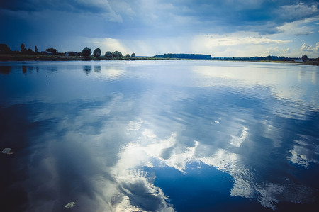 mirror image: lake and the mirror image of storm clouds, Blue colour