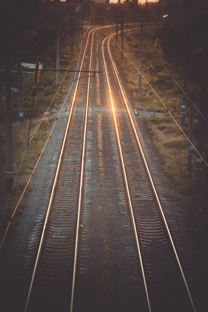 rail track: background rail track from the top and reflection at sunset dawn Stock Photo