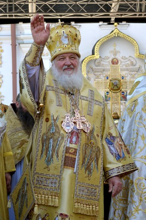 rus: Kiev, Ukraine, celebration liturgy in honor of the baptism of Rus in Kiev Pechersk Lavra - 27 July 2013 -: Patriarch Kirill Gundyaev welcomes people standing and waving his hand, lifting it up