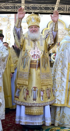 liturgy: Kiev, Ukraine, celebration liturgy in honor of the baptism of Rus in Kiev Pechersk Lavra - 27 July 2013 -: Patriarch Kirill welcomes people standing and waving both hands