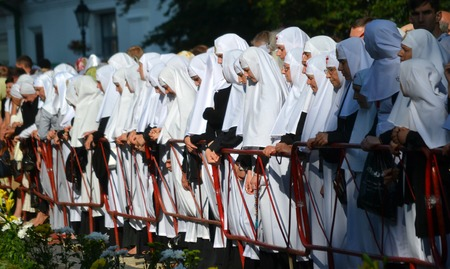 Kiev, Ukraine, celebration liturgy in honor of the baptism of Rus in Kiev Pechersk Lavra - 27 July 2013 -: Sisters of Mercy standing near the fence, head bowed Editorial