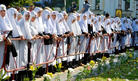 rus: Kiev, Ukraine, celebration liturgy in honor of the baptism of Rus in Kiev Pechersk Lavra - 27 July 2013 -: Sisters of Mercy standing near the fence, head bowed Editorial