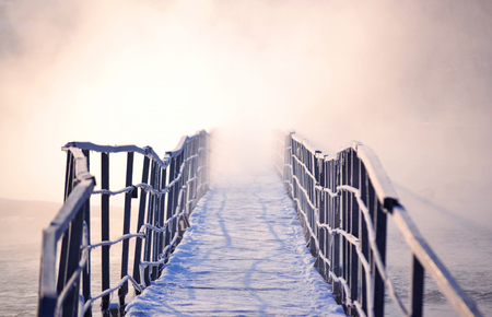 icy bridge with morning fog in winter. Road into the unknown, filter