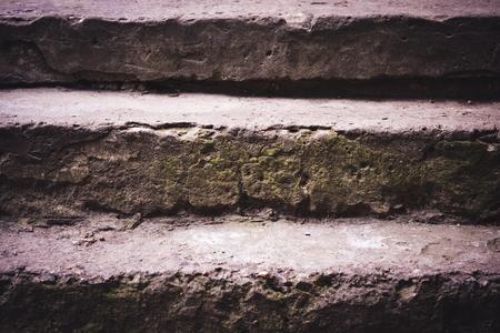 concrete steps: old shabby concrete steps close-up dark filter